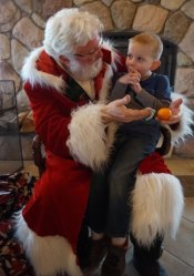Santa visiting with a young lad