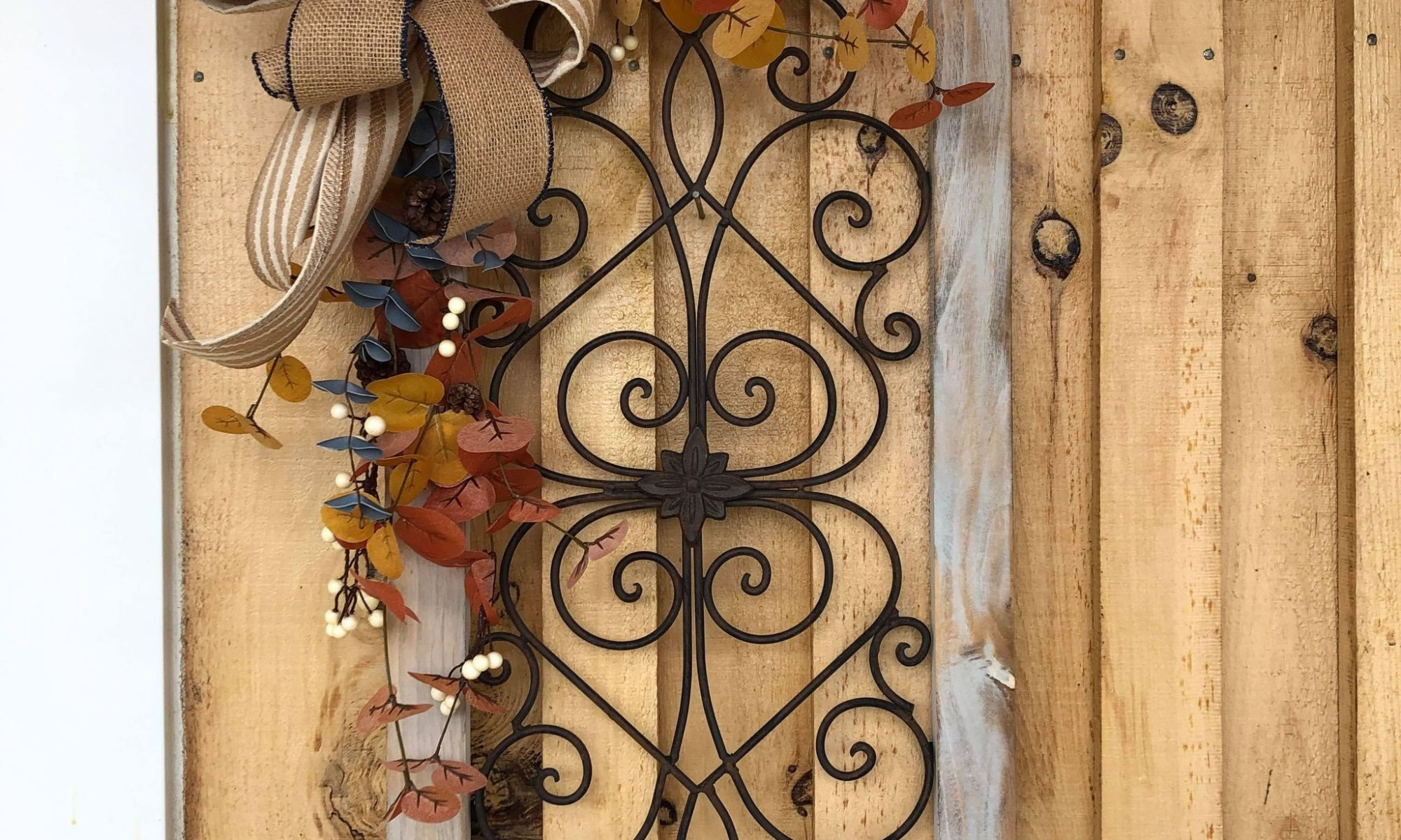 Frame with wrought iron scrollwork and autumn details