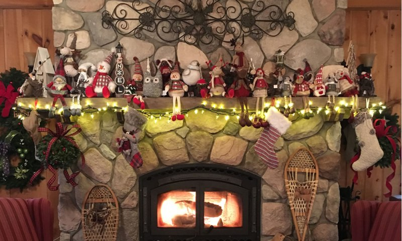 Christmas gift and decor items lined up on the hearth